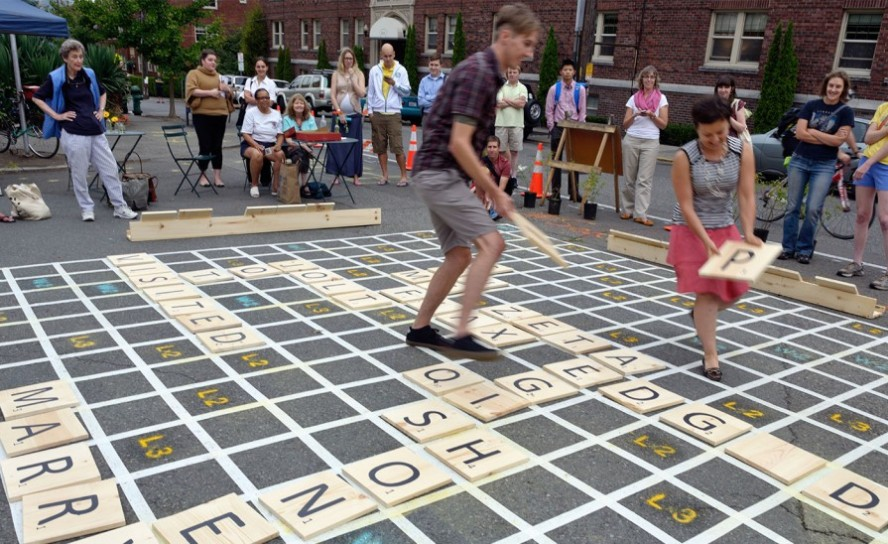 People playing Street Scrabble